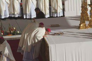 images bishop cunningham kisses altar 300x200 300x200 - images_bishop cunningham kisses altar-300x200