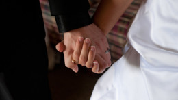 images cover photo just use hands 260x146 - GROOM, BRIDE HOLD HANDS ON THEIR WEDDING DAY