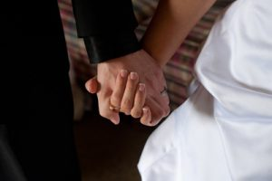 images cover photo just use hands 300x200 - GROOM, BRIDE HOLD HANDS ON THEIR WEDDING DAY