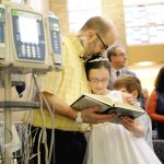 images page 16 pic communion 150x150 - Dad waiting for heart transplant gets to see daughter's first Communion in New York hospital