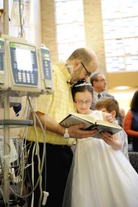 images page 16 pic communion 200x300 - Dad waiting for heart transplant gets to see daughter's first Communion in New York hospital
