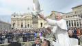 images popeanddove 120x67 - Pope Francis holds dove before his weekly audience at the Vatican