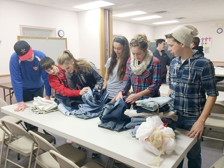 Teens collect blue jeans for local homeless youth