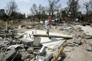 kat 1 300x200 - Father and daughter walk through rubble after Hurricane Katrina in 2005