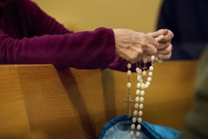 20141125cm01624 1 300x200 - Woman prays rosary in Ferguson, Mo., Catholic church as violence erupts following grand jury decision in shooting of black teen