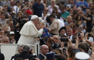 20150902cnsbr0363 1 300x192 - Pope Francis kisses child as he arrives to lead general audience in St. Peter's Square at Vatican