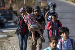 20150904cnsbr0405 1 300x200 - Migrants from Syria walk along road in village of Miratovac, Serbia