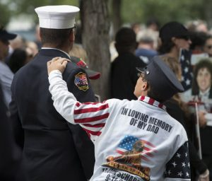 20150911cnsbr0606 1 300x256 - Boy places his hand on firefighter's shoulder during ceremony marking 14th anniversary of 9/11 attacks