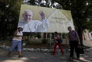 20150915cnsto0002 1 300x205 - Cubans walk under a Pope Francis billboard in Havana