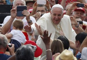 20150916cnsbr0677 1 300x208 - Pope Francis reaches to bless baby during general audience in St. Peter's Square at Vatican