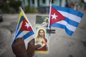 20150920cnsnw0064 1 300x200 - Woman holds flags, holy cards featuring images of Christ in Havana