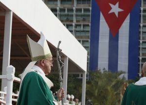 20150920cnsnw0068 1 1 300x216 - Cuba's flag seen as Pope Francis arrives to celebrate Mass in Revolution Square in Havana