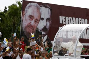 20150920cnsnw0095 1 300x200 - Pope Francis waves to people as he passes billboard showing images of Cuba's former leader Fidel Castro, Jose Marti