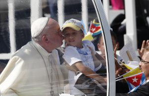20150921cnsnw0190 1 300x194 - Pope Francis kisses child as he arrives to celebrate Mass in Revolution Square in Holguin
