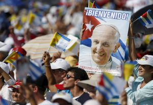 20150921cnsnw0203 1 300x206 - People cheer as Pope Francis arrives for Mass in Revolution Square in Holguin