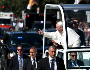 20150923cnsnw00085 1 300x233 - Pope Francis gives thumbs as he rides down Constitution Avenue in Washington