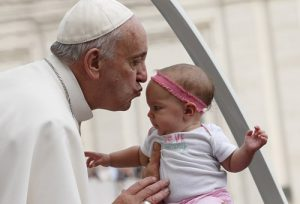 20151014cnsbr0942 1 300x204 - Pope Francis kisses baby as he arrives to lead general audience in St. Peter's Square