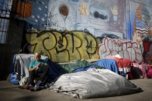 20151015cnsbr0988 1 300x200 - Woman sits outside tent on Skid Row in downtown Los Angeles