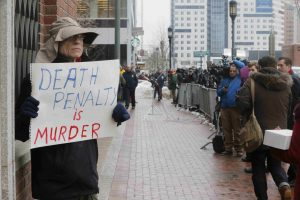 20150305cnsbr8401 1 300x200 - Man holds sign reading 'Death penalty is murder' outside trial of accused Boston Marathon bomber