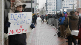 20150305cnsbr8401 260x146 - Man holds sign reading 'Death penalty is murder' outside trial of accused Boston Marathon bomber