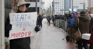 20150305cnsbr8401 600x315 300x158 - Man holds sign reading 'Death penalty is murder' outside trial of accused Boston Marathon bomber
