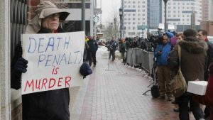 20150305cnsbr8401 777x437 300x169 - Man holds sign reading 'Death penalty is murder' outside trial of accused Boston Marathon bomber