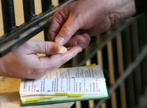 20150803cnsbr0035 1 300x221 - Deacon distributes Communion to a death-row inmate