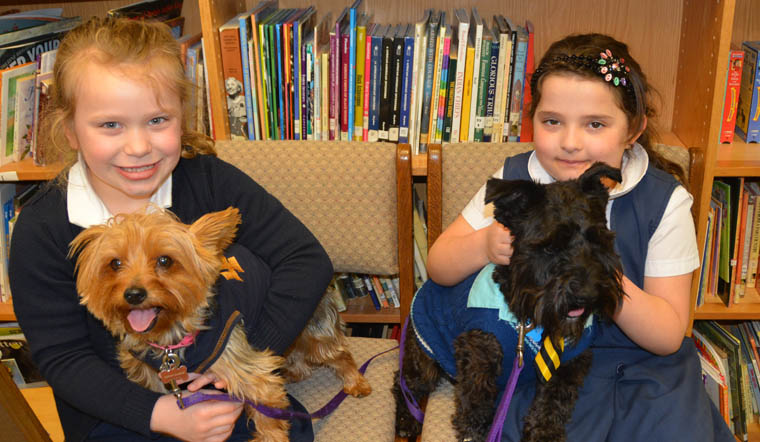 Furry friends help reluctant readers