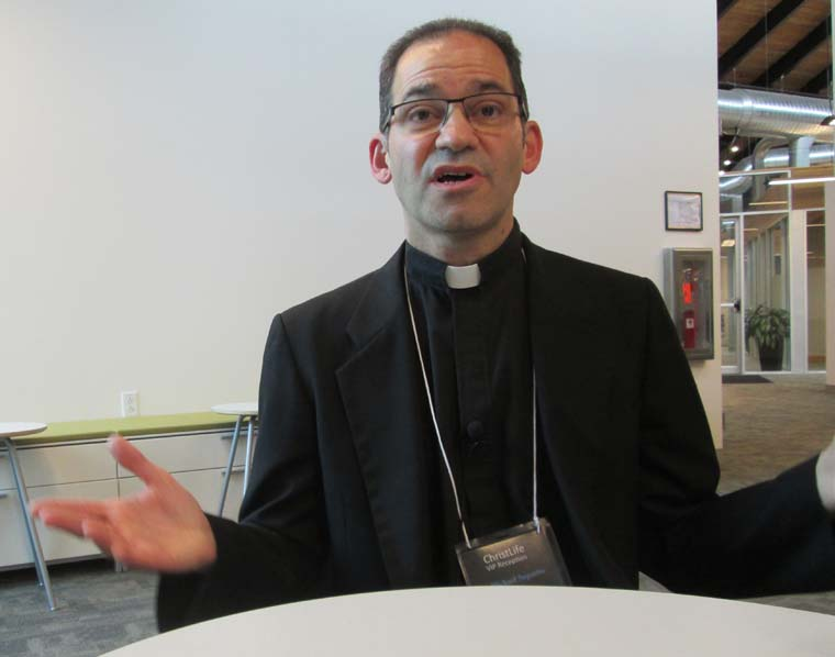 Visiting priest energizes 'Discovering Christ' sessions