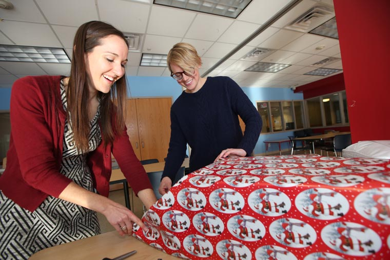 Volunteers help children in need feel joy of Christmas with donated toys