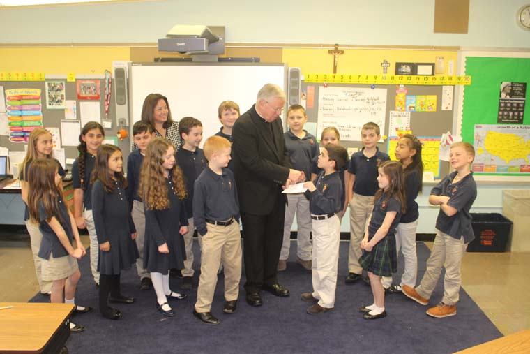 Holy Cross class makes donation to Cathedral Restoration Fund