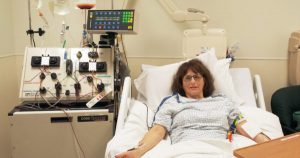 Susan in hospital bed 600x315 300x158 - Susan-in-hospital-bed-600x315