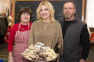 Toni Amodio holds tray of cookies 300x200 - Toni-Amodio-holds-tray-of-cookies