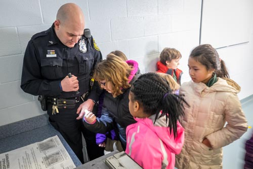 StJames catholicschoolweek 2 1 - St. James students deliver gifts to police on Day of Service
