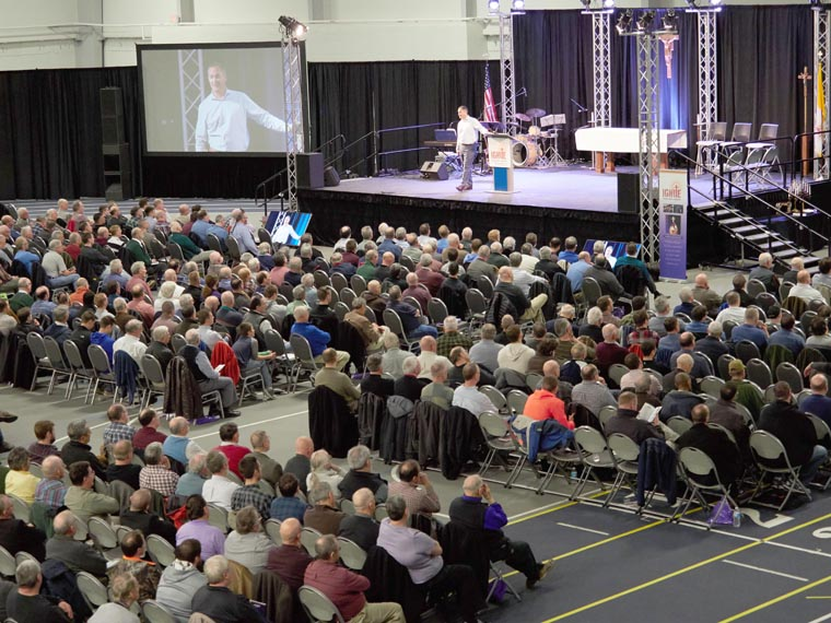 Crowd encouraged to be courageous men of action