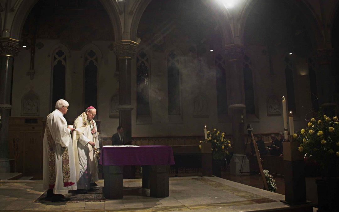 Bishop Moynihan remembered as 'an inspiration' at vigil
