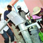 Four men pump water from a well similar to those funded by the Liverpool parishioners generous donations to Cross Catholic Outreach copy 1 150x150 - Church's Haiti Committee raises $1,250 for school lunches in twin parish
