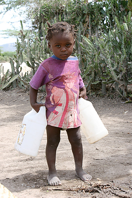 carrying water 1 - Liverpool parish raises thousands for well in Haiti