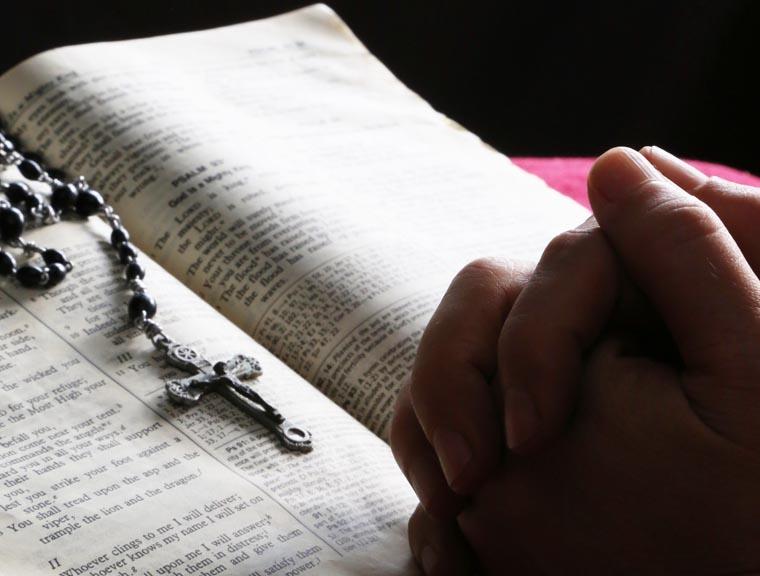 Father Manno monitors seminarians' progress