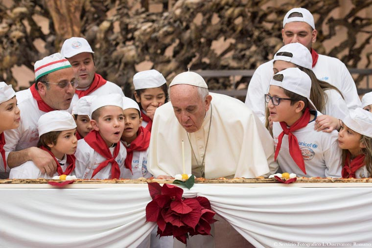 As pope turns 81, kids entertain with song, dance and 13-foot pizza