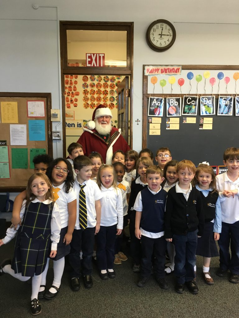 unnamed 2 768x1024 - St. Nick visits Notre Dame Elementary
