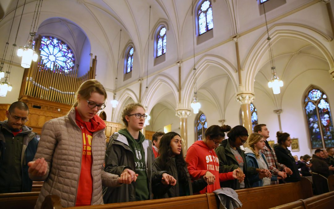 Catholic school students join peers in march against gun violence
