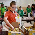 Blessed Sacrament boy 150x150 - Jolly volunteers fill goodie bags for inmates