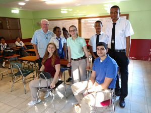 students in classroom with Brother 300x225 - CBA students spend winter break on service trip in Jamaica