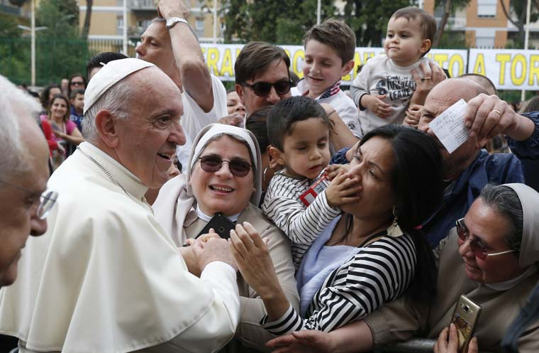 Love is constant caring for others, pope says at parish visit