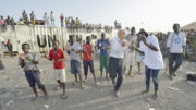 Father Bassano dances 180x101 - Priest lives with -- and dances with -- the displaced in South Sudan