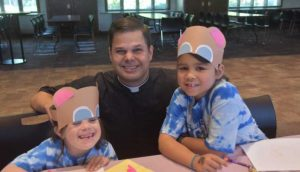 Father Zach Miller with 2 IC kids 1 300x172 - Father-Zach-Miller-with-2-IC-kids