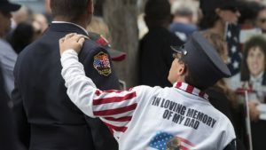 20150911cnsbr0606 300x169 - Boy places his hand on firefighter's shoulder during ceremony marking 14th anniversary of 9/11 attacks