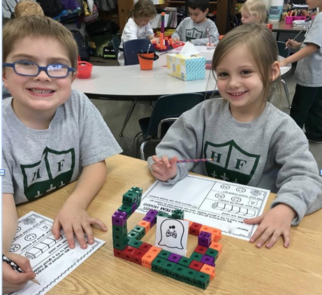Holy Family students work on Halloween STREAM project
