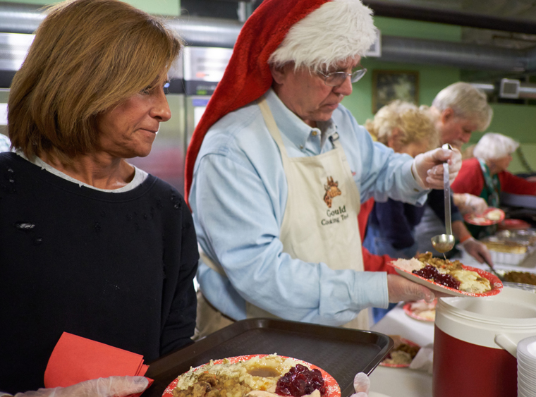 'It takes a small army': All Saints volunteers prepare and serve up Christmas feast for charity